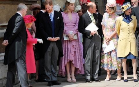Prince Harry talks to the Queen at today's royal wedding - Credit: Getty