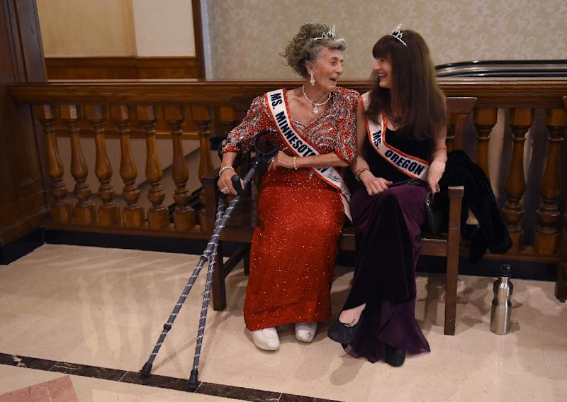 Ms. Minnesota Liz Johnson (L) talks with Ms. Oregon Dianne Hennacy Powell before the finals of the 38th Annual National Ms.Senior America 2017 Pageant, at the Resorts Casino Hotel in Atlantic City, New Jersey, on October 19, 2017 (AFP Photo/TIMOTHY A. CLARY)