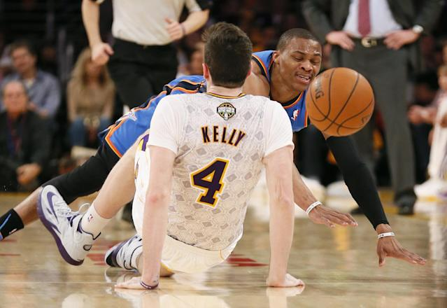 Oklahoma City Thunder point guard Russell Westbrook is called for an offensive foul and then a technical foul after colliding with Los Angeles Lakers power forward Ryan Kelly (4) during the first half of an NBA basketball game in Los Angeles, Sunday, March 9, 2014. (AP Photo/Danny Moloshok)