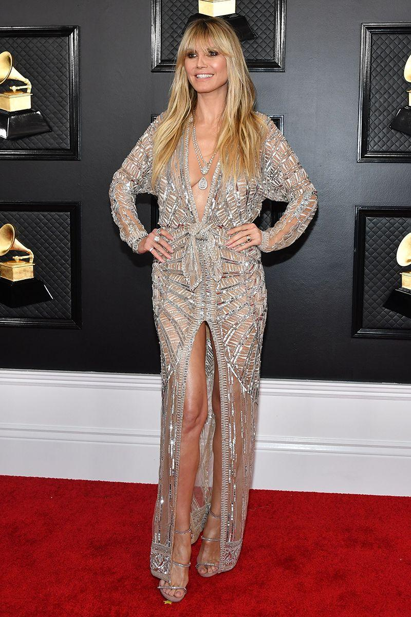 <p>Heidi Klum is a naked dress professional, perfectly balancing sheer panels with ornate detailing and tactfully-placed splits.</p>