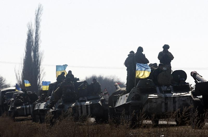 A column of Ukrainian Armoured Personnel Carriers near the eastern city of Soledar, in the Donetsk region, on February 27, 2015