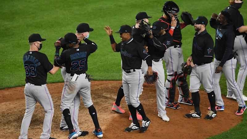 Marlins, Reds clinch MLB playoff spots