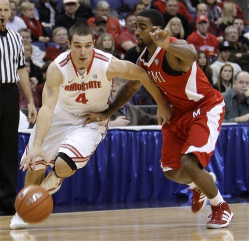 Ohio State's Aaron Craft, left, drives the baseline against Miami (Ohio)'s Quinten Rollins during the first half of an NCAA college basketball game Thursday, Dec. 22, 2011, in Columbus, Ohio. (AP Photo/Jay LaPrete)