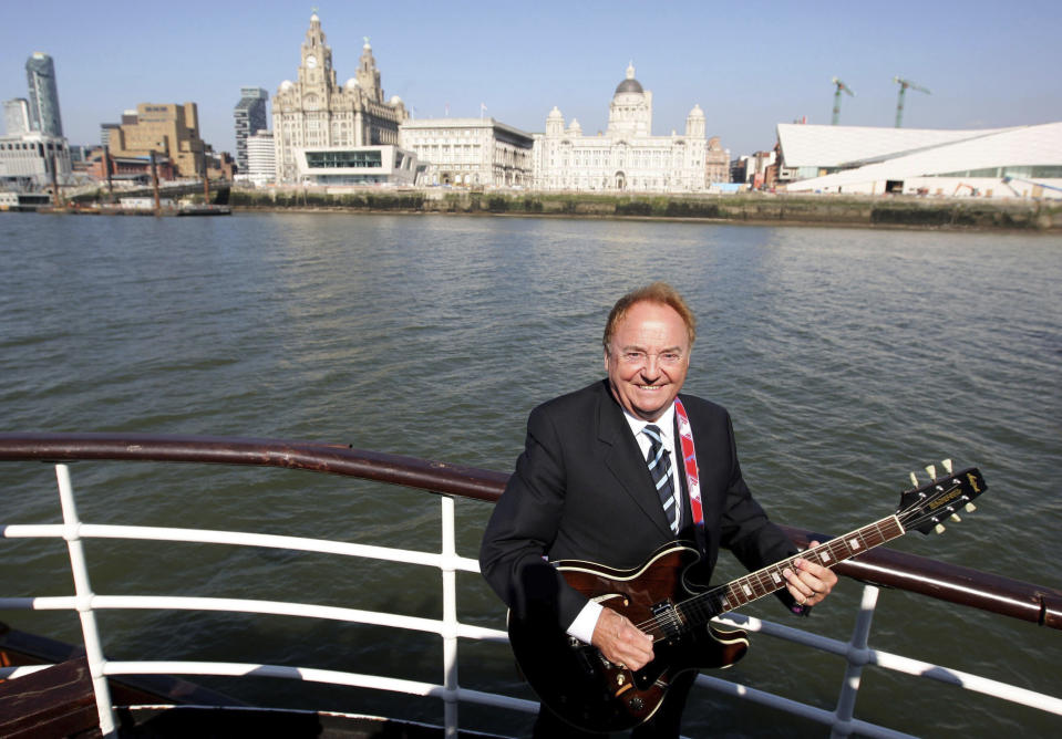 "FILE - This April 20, 2009 file photo shows Gerry Marsden on board the Mersey ferry. Gerry Marsden, the British singer and lead singer of Gerry and the Pacemakers, who was instrumental in turning a song from the Rodgers and Hammerstein musical ""Carousel"" into one of the great anthems in the world of football, has died. He was 78. (Dave Thompson/PA via AP, File)"