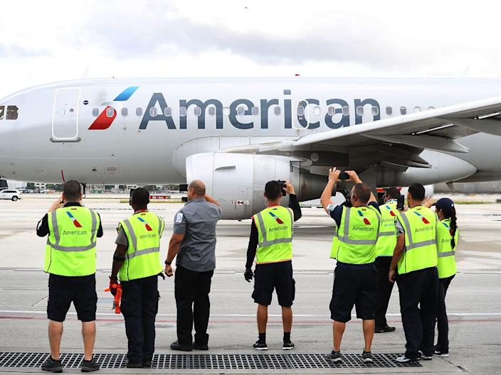 "Employees watch as American Airlines Flight 903 prepares for take off from Miami in 2016. <p class=""copyright"">Joe Raedle/Getty Images</p>"