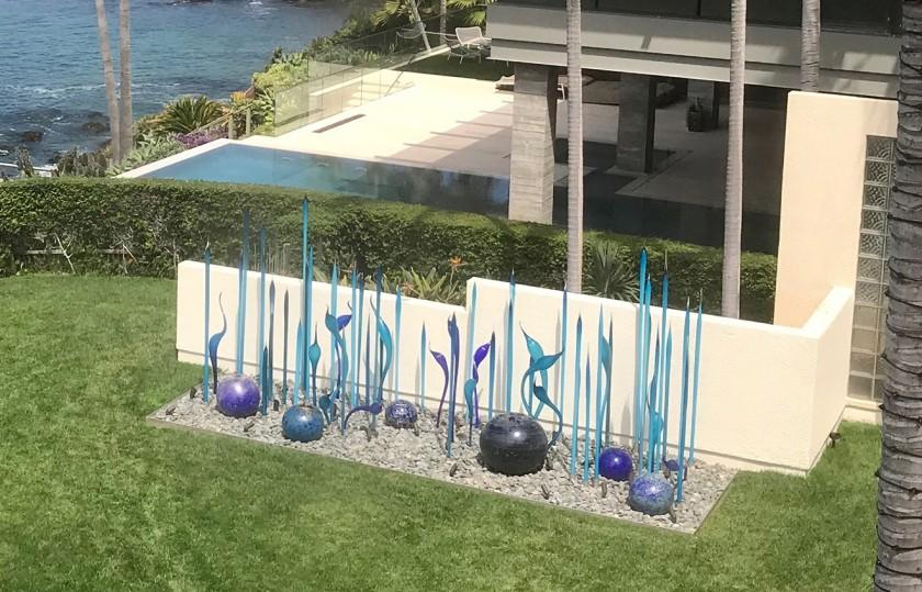 Blown glass sculpture by artist Dale Chihuly installed at the Laguna Beach yard of Bill Gross and Amy Schwartz.