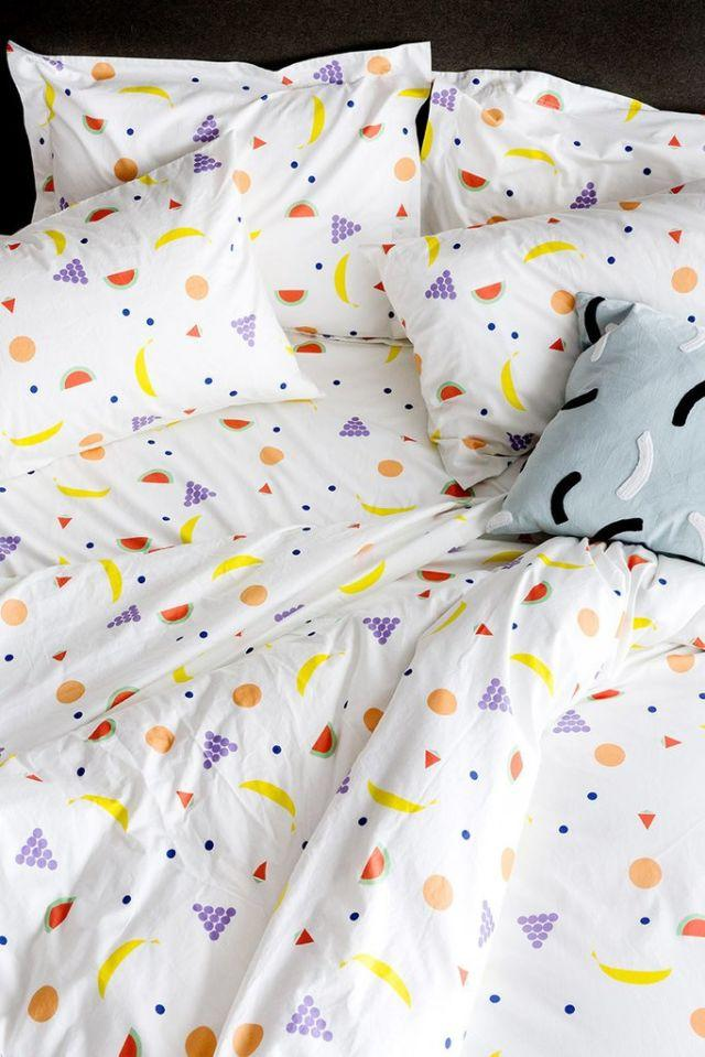 """<p>Chances are, your bed is the biggest piece of furniture in your room, and it's the focal point by default. If your living space is feeling a bit drab, swap out your plain white sheets and comforter for linens in playful prints and sorbet hues. <span></span></p><p><span>Fruit Bedding, from $38, <a rel=""""nofollow"""" href=""""https://www.dusendusen.com/collections/bedding/products/fruit-bedding-pre-order""""><u>dusendusen.com</u></a>.<span></span><br></span></p>"""