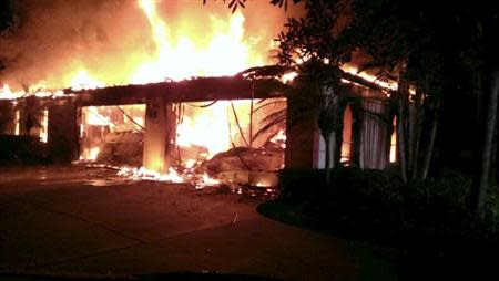 Handout photo of flames engulfing a house owned by former tennis pro James Blake in Tampa