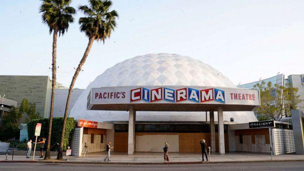 PHOTO: Bystanders gather outside the Cinerama Dome movie theater, Monday, April 12, 2021, in Los Angeles.  (Chris Pizzello/AP)
