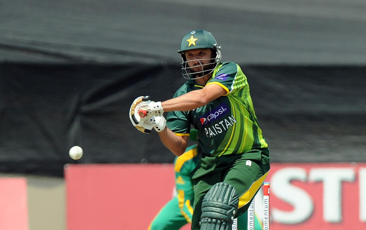 Pakistan's cricketer Shahid Afridi  plays a shot during the fifth and final One-Day Internationals (ODI) cricket match between South Africa and Pakistan in Benoni at Willowmoore Park on March 24, 2013. AFP PHOTO / ALEXANDER JOE        (Photo credit should read ALEXANDER JOE/AFP/Getty Images)