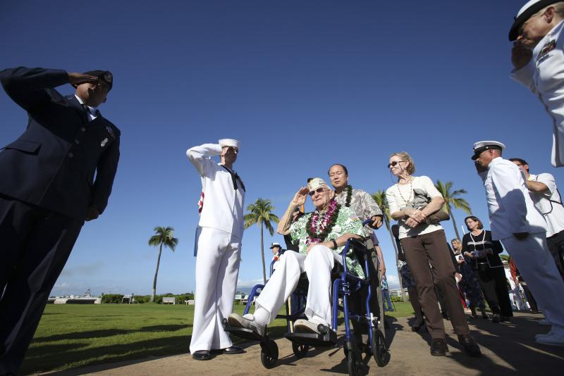 "Pearl Harbor survivor Highland salutes during the ""Walk of Honor"" at the 72nd anniversary of the attack on Pearl Harbor at the WW II Valor in the Pacific National Monument in Honolulu"