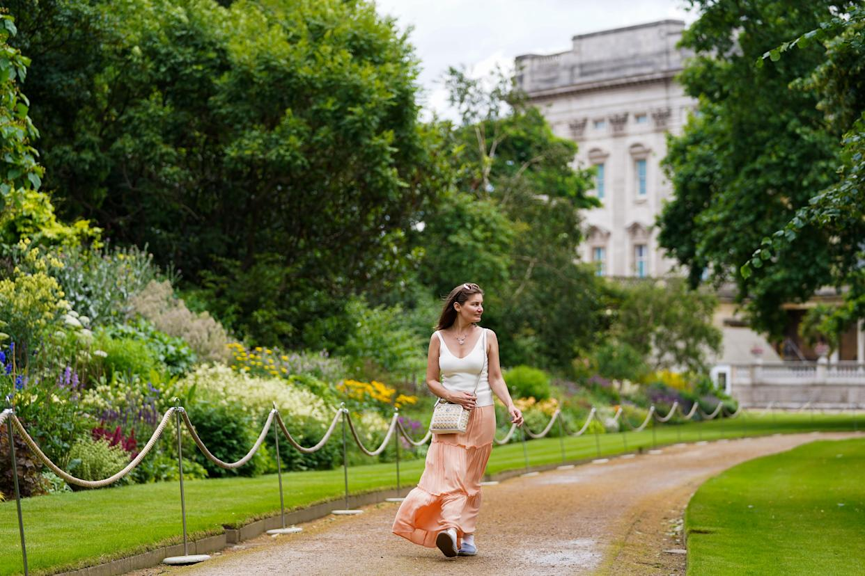 A visitor enjoys the garden during a preview of the Garden at Buckingham Palace, Queen Elizabeth II's official residence in London, which opens to members of the public on Friday. Visitors will be able to picnic in the garden and explore the open space for the first time. Picture date: Thursday July 8, 2021. (Photo by Kirsty O'Connor/PA Images via Getty Images)