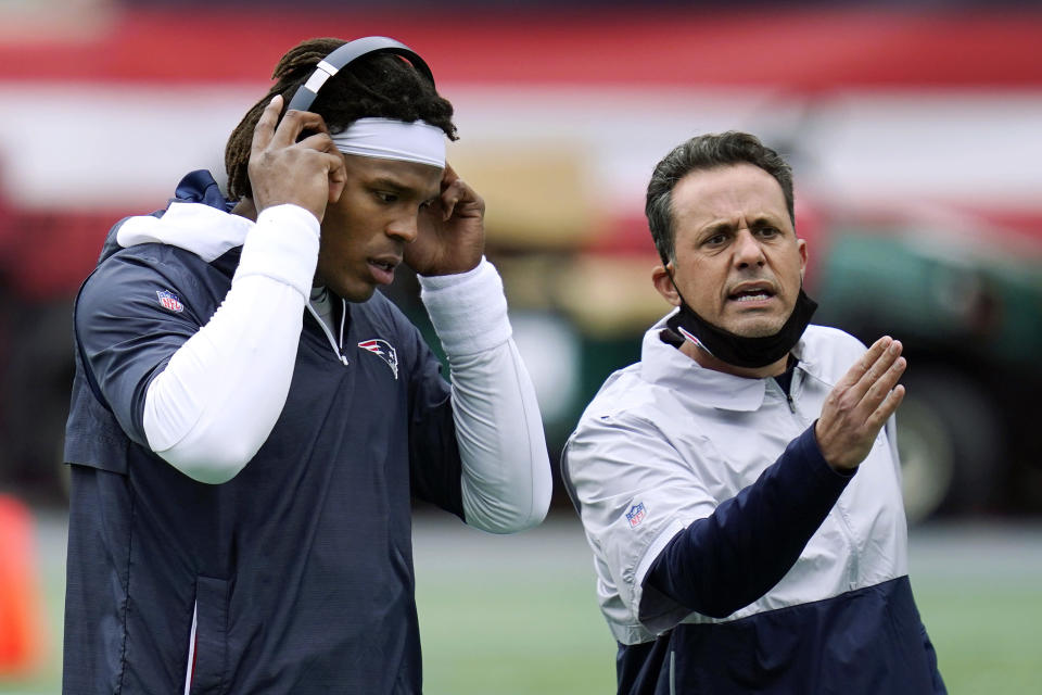 FILE - In this Oct. 26, 2020, file photo, New England Patriots quarterback Cam Newton, left, stands beside quarterback coach Jedd Fisch before an NFL football game against the San Francisco 49ers in Foxborough, Mass. Arizona took an unusual step by hiring Jedd Fisch as its football coach. The 44-year-old has a long resume, mostly in the NFL, but did not play football and has limited experience as a head coach, serving as UCLA's interim coach for two games in 2017.(AP Photo/Charles Krupa, File)