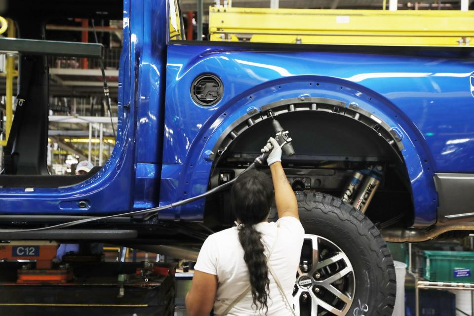 In this Sept. 27, 2018, file photo a United Auto Workers assemblyman works on a 2018 Ford F-150 truck being assembled at the Ford Rouge assembly plant in Dearborn, Mich. (AP Photo/Carlos Osorio, File)