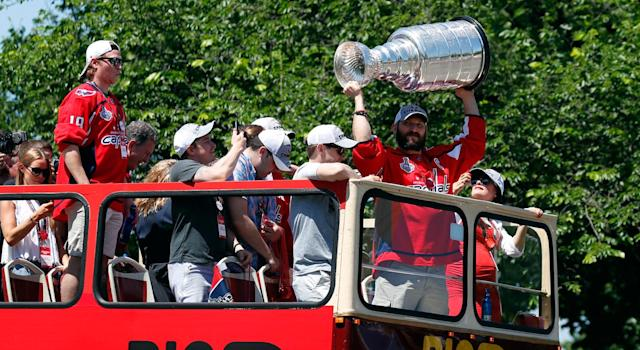 Alex Ovechkin hoists the Stanley Cup during parade in Washington. (Getty)