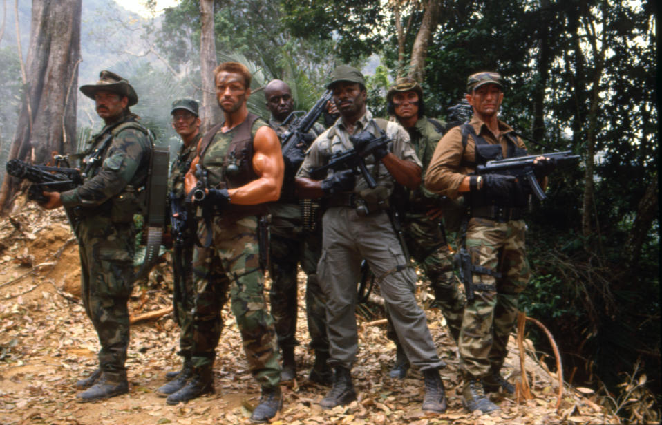 """Jesse Ventura, Arnold Schwarzenegger and Carl Weathers on the set of """"Predator"""". (Photo by Sunset Boulevard/Corbis via Getty Images)"""