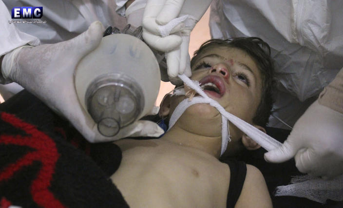 <p>This photo provided Tuesday, April 4, 2017 by the Syrian anti-government activist group Edlib Media Center, which has been authenticated based on its contents and other AP reporting, shows Syrian doctors treating a child following a suspected chemical attack, at a makeshift hospital, in the town of Khan Sheikhoun, northern Idlib province, Syria. The suspected chemical attack killed dozens of people on Tuesday, Syrian opposition activists said, describing the attack as among the worst in the country's six-year civil war. (Edlib Media Center, via AP) </p>
