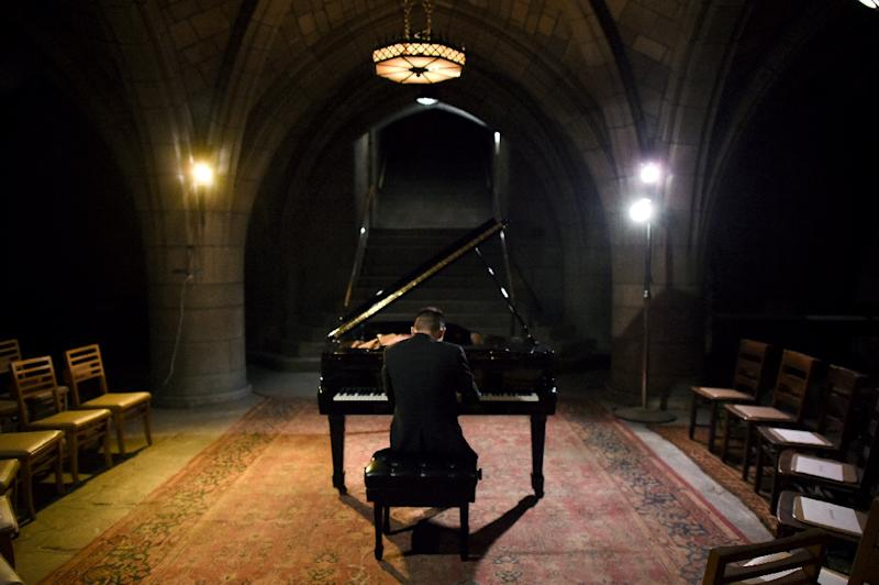 Musician Conrad Tao, a young classical composer warms-up before his concert in the basement crypt in Harlem's Church of the Intercession on November 5, 2015 in New York