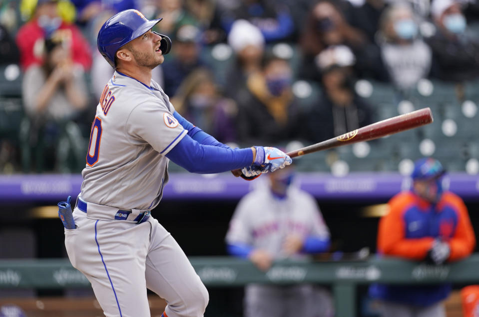 New York Mets' Pete Alonso flies out against Colorado Rockies relief pitcher Mychal Givens in the eighth inning of a baseball game Sunday, April 18, 2021, in Denver. (AP Photo/David Zalubowski)