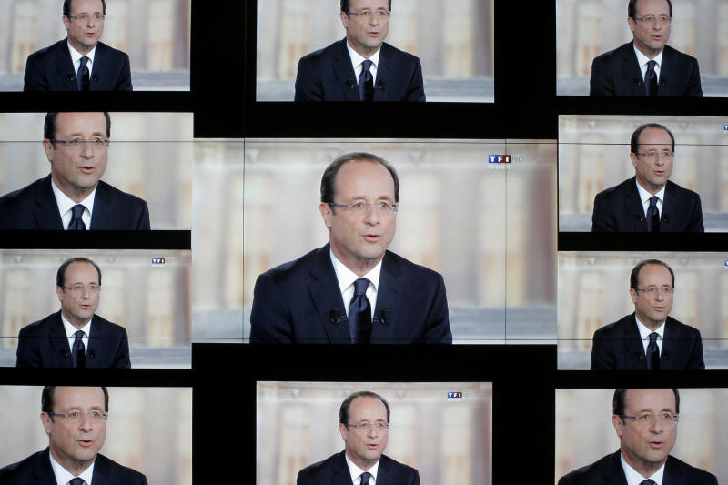 "Socialist Party candidate for the presidential election Francois Hollande, is seen on a wall screen during the televised debate with  President and conservative rival Nicolas Sarkozy, at the TF1 television studio, in Boulogne-Billancourt, outside Paris, Wednesday, May 2, 2012. The prime-time debate between conservative incumbent Sarkozy and his leftist challenger Hollande is billed in newspaper headlines Wednesday as ""The Last Duel"" and ""The Final Confrontation,"" providing a sense of suspense in a campaign that, if polls are right, has lacked it from the beginning. (AP Photo/Thibault Camus)"