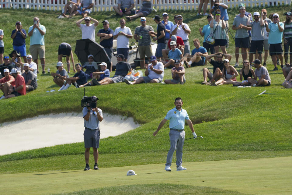 Louis Oosthuizen throws his hat to the ground in reaction to nearly sinking a long approach shot on the 18th hole during the final round of the 3M Open golf tournament in Blaine, Minn., Sunday, July 25, 2021. (AP Photo/Craig Lassig)