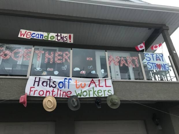 A home in Saskatoon offers words of support to front-line workers during the COVID-19 pandemic.  (Guy Quenneville/CBC - image credit)
