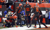 Cleveland Browns wide receiver Rashard Higgins (81) celebrates with teammates after scoring a 17-yard touchdown during the second half of an NFL football game against the Cincinnati Bengals, Sunday, Dec. 23, 2018, in Cleveland. (AP Photo/Ron Schwane)