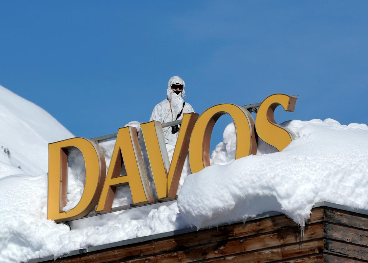 A Swiss special police officer observes the surrounding area from atop the roof of the Davos Congress Hotel during the World Economic Forum (WEF) annual meeting in Davos, Switzerland January 24, 2018.  REUTERS/Denis Balibouse