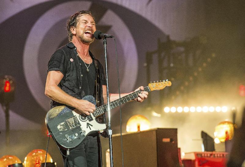 FILe - In this June 11, 2016, file photo, Eddie Vedder of Pearl Jam performs at Bonnaroo Music and Arts Festival in Manchester, Tenn. The late rapper Tupac Shakur and Seattle-based rockers Pearl Jam are among the first-time nominees on the ballot for induction next year into the Rock and Roll Hall of Fame. (Photo by Amy Harris/Invision/AP, File)