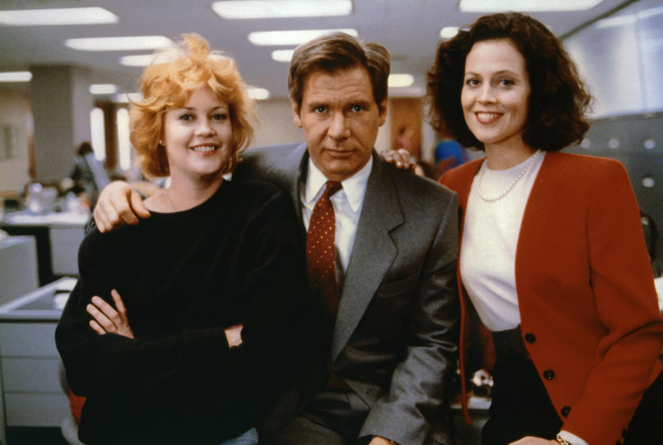 American actors Melanie Griffith, Harrison Ford and Sigourney Weaver on the set of Working girl directed by German-born American Mike Nichols. (Photo by Sunset Boulevard/Corbis via Getty Images)
