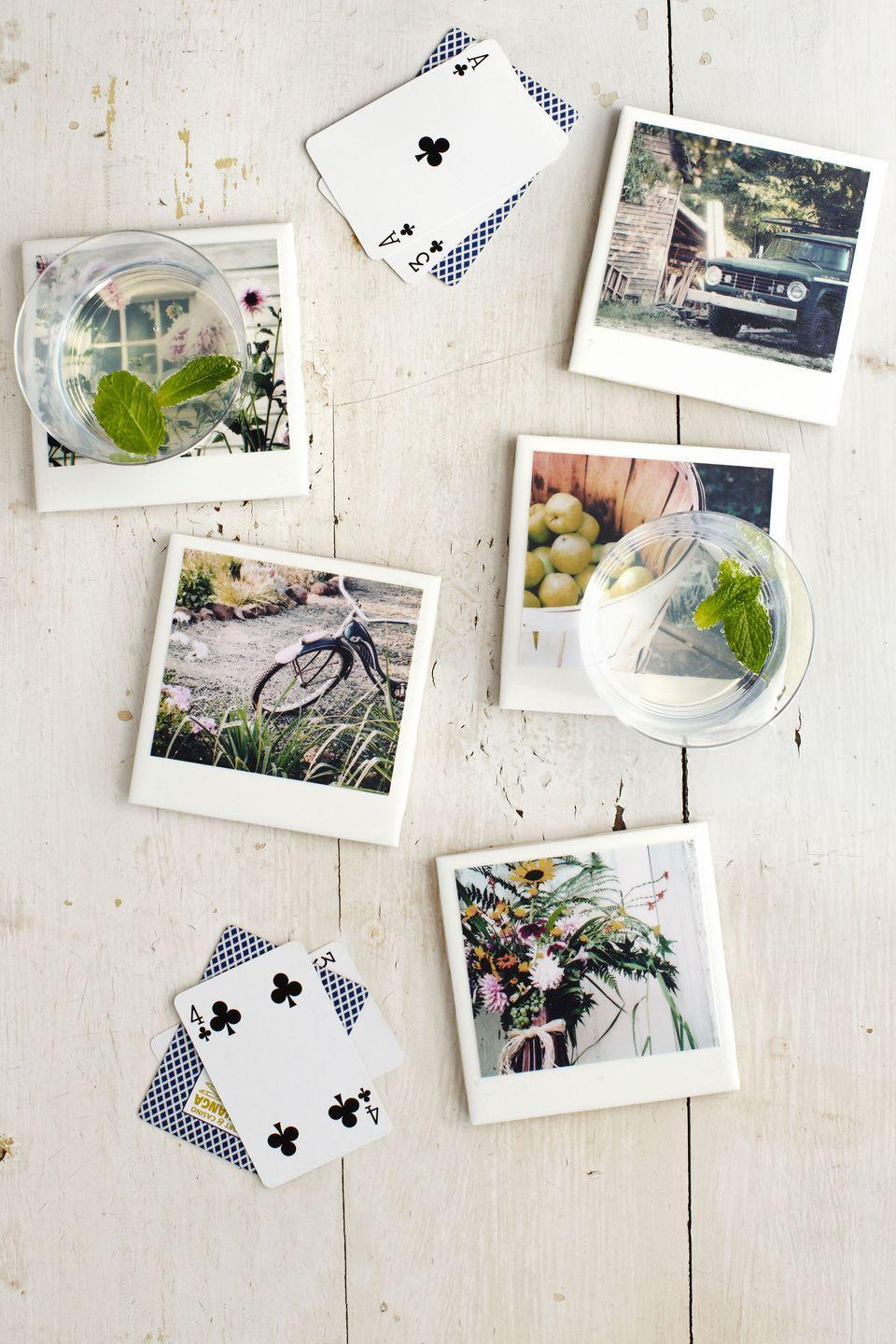 """<p>Refocus plain ceramic tiles as snappy coasters. Blogger Brittany Moser of <a href=""""http://www.darkroomanddearly.com"""" rel=""""nofollow noopener"""" target=""""_blank"""" data-ylk=""""slk:darkroomanddearly.com"""" class=""""link rapid-noclick-resp"""">darkroomanddearly.com</a> made these Polaroid-inspired drink rests from color photos and square tiles (a steal at 98 cents apiece). First, trim a photo to 3 3/4""""W x 3 1/4""""H. Using a foam brush, spread <a href=""""https://www.amazon.com/Mod-Podge-Waterbase-8-Ounce-CS11301/dp/B000HWY6EM?tag=syn-yahoo-20&ascsubtag=%5Bartid%7C10050.g.645%5Bsrc%7Cyahoo-us"""" rel=""""nofollow noopener"""" target=""""_blank"""" data-ylk=""""slk:Mod Podge"""" class=""""link rapid-noclick-resp"""">Mod Podge</a> on the back of the image; then position it on <a href=""""https://go.redirectingat.com?id=74968X1596630&url=http%3A%2F%2Fwww.homedepot.com%2Fp%2FMerola-Tile-Twist-Square-White-Ice-3-3-4-in-x-3-3-4-in-Ceramic-Wall-Tile-WRC4TWWI%2F205703723&sref=https%3A%2F%2Fwww.countryliving.com%2Fdiy-crafts%2Ftips%2Fg645%2Fcrafty-christmas-presents-ideas%2F"""" rel=""""nofollow noopener"""" target=""""_blank"""" data-ylk=""""slk:a tile"""" class=""""link rapid-noclick-resp"""">a tile</a>, leaving a 1/4-inch border at the top and sides, and a 3/4-inch border at the bottom. Let dry for 30 minutes. Spread Mod Podge over the photo and exposed tile borders and let dry for one hour; repeat two to three more times. Spray with clear sealant and let dry for 24 hours. Finally, affix <a href=""""https://www.amazon.com/Waxman-Self-Stick-Round-Brown-8-Inch/dp/B000VYN7CS?tag=syn-yahoo-20&ascsubtag=%5Bartid%7C10050.g.645%5Bsrc%7Cyahoo-us"""" rel=""""nofollow noopener"""" target=""""_blank"""" data-ylk=""""slk:adhesive felt pads"""" class=""""link rapid-noclick-resp"""">adhesive felt pads</a> to the underside corners of your picture-perfect tiles.</p><p><strong><a class=""""link rapid-noclick-resp"""" href=""""https://go.redirectingat.com?id=74968X1596630&url=https%3A%2F%2Fwww.homedepot.com%2Fp%2FMerola-Tile-Twist-Square-White-Ice-3-3-4-in-x-3-3-4-in-Ceramic-Wall-Tile-WRC4TWWI%2F20570372"""