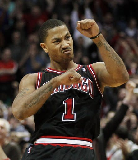 Chicago Bulls' Derrick Rose reacts after his game-winning shot against the Milwaukee Bucks during the second half of an NBA basketball game Wednesday, March 7, 2012, in Milwaukee. Rose drilled a long jumper at the buzzer, powering the Bulls to a 106-104 victory over the Bucks. (AP Photo/Jeffrey Phelps)