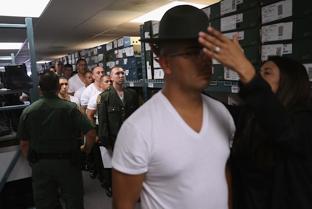 <p>A new U.S. Border Patrol trainee is fitted for a uniform at the U.S. Border Patrol Academy on August 3, 2017 in Artesia, N.M. (Photo: John Moore/Getty Images) </p>