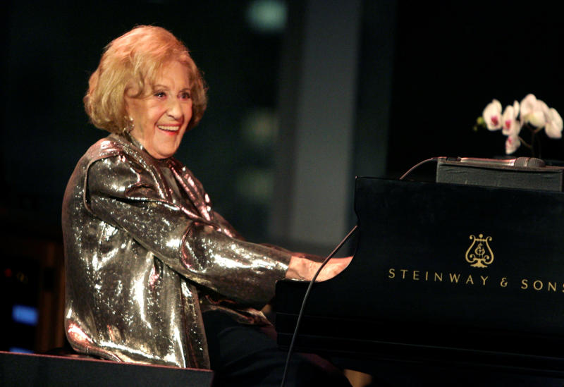 "FILE - In this March 19, 2008 file photo, Marian McPartland smiles while playing the piano during a celebration of her 90th birthday in New York. McPartland, 95, the legendary jazz pianist and host of the National Public Radio show ""Piano Jazz,"" died of natural causes Tuesday, Aug. 20, 2013 at her Port Washington home on Long Island. (AP Photo/Seth Wenig, File)"