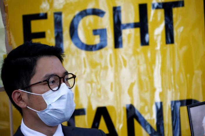 FILE PHOTO: Hong Kong exile pro-democracy activist Nathan Law holds a rally in Berlin