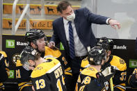 Boston Bruins head coach Bruce Cassidy instructs his players in the third period of an NHL hockey game against the Philadelphia Flyers, Thursday, Jan. 21, 2021, in Boston. (AP Photo/Elise Amendola)