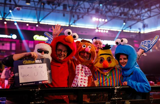 Fresh from Sesame Street, these fans made an appearance with... Santa? (Photo by Steven Paston/PA Images via Getty Images)