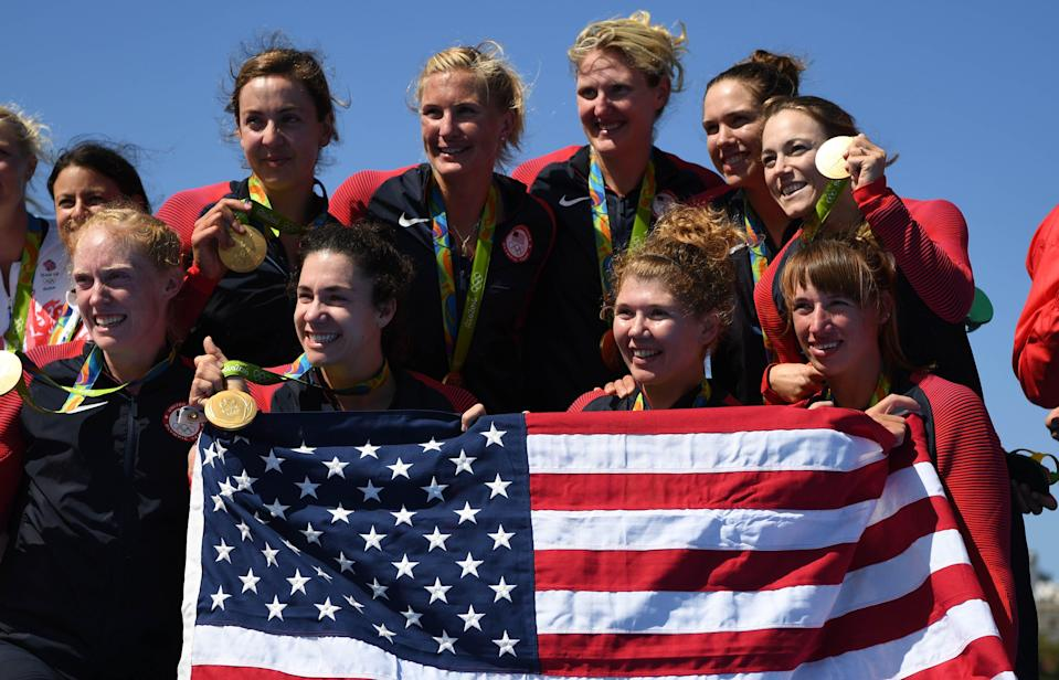 Team USA celebrates winning gold after the women's eight rowing competition in the Rio 2016 Summer Olympic Games at Lagoa Stadium.