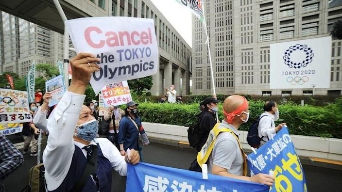 People stage a demonstration against Tokyo Olympics in front of the Tokyo Metropolitan Government in Tokyo, Japan on June 6, 2021.