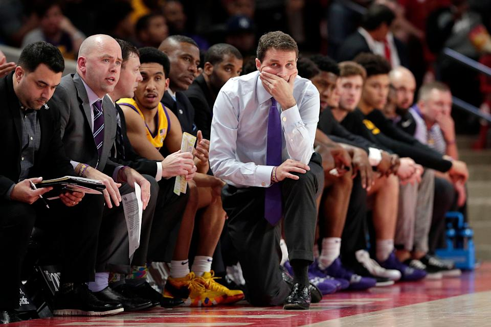 LSU head coach Will Wade kneels at his bench in the final minutes of their loss to Houston during the second half of an NCAA college basketball game, Wednesday, Dec. 12, 2018, in Houston. (AP Photo/Michael Wyke)
