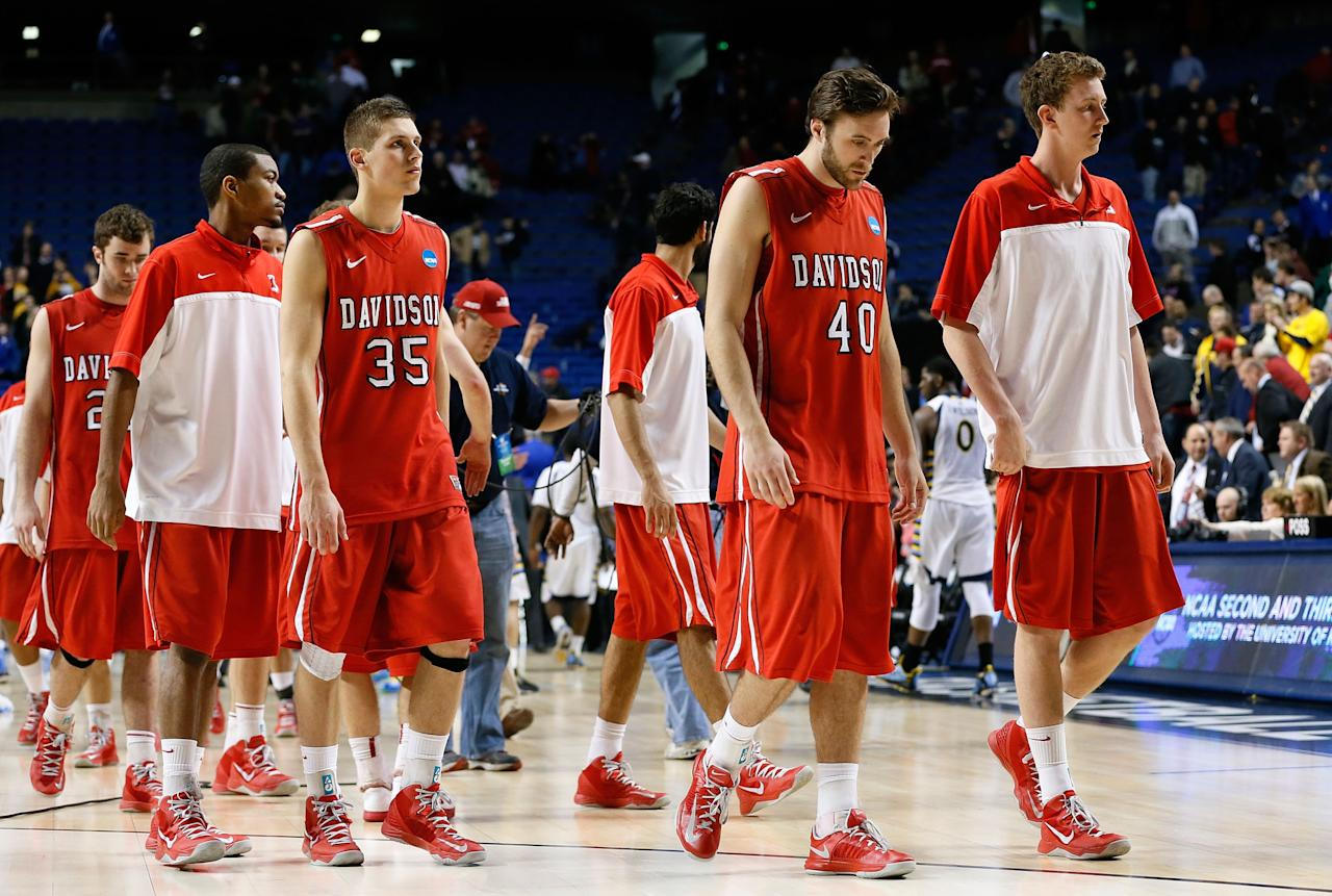 LEXINGTON, KY - MARCH 21:  The Davidson Wildcats walk off the court after losing 59-58 to the Marquette Golden Eagles during the second round of the 2013 NCAA Men's Basketball Tournament at the Rupp Arena on March 21, 2013 in Lexington, Kentucky.  (Photo by Kevin C. Cox/Getty Images)