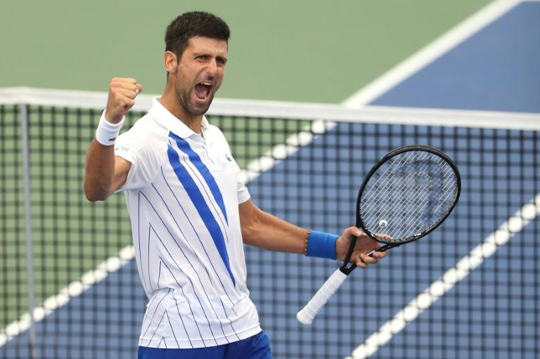 Djokovic rallies past Raonic to win US Open tuneup title