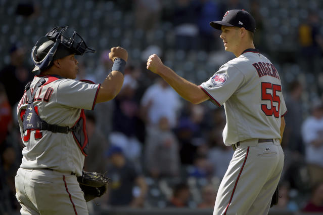 Minnesota Twins relief pitcher Taylor Rogers (55) celebrates with catcher Willians Astudillo (64) after defeating the Baltimore Orioles 4-3, Sunday, April 21, 2019, in Baltimore. (AP Photo/Will Newton)