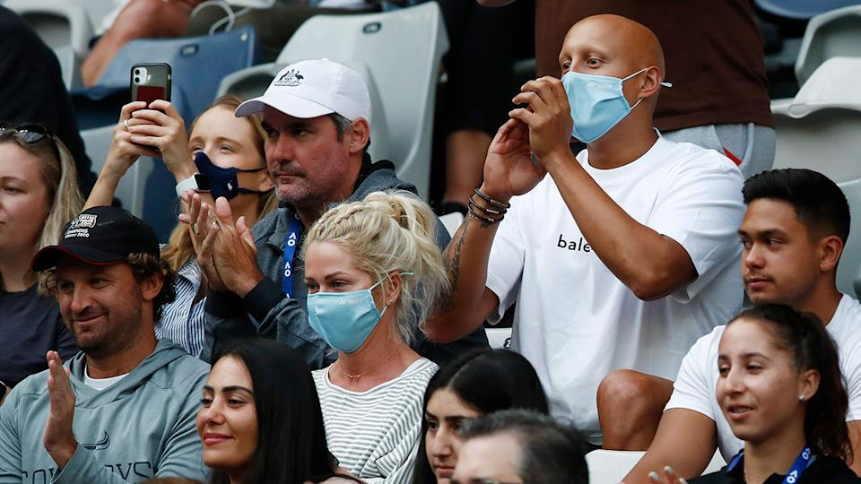 Seen here, fans of Nick Kyrgios cheer the Aussie on against Dominic Thiem.
