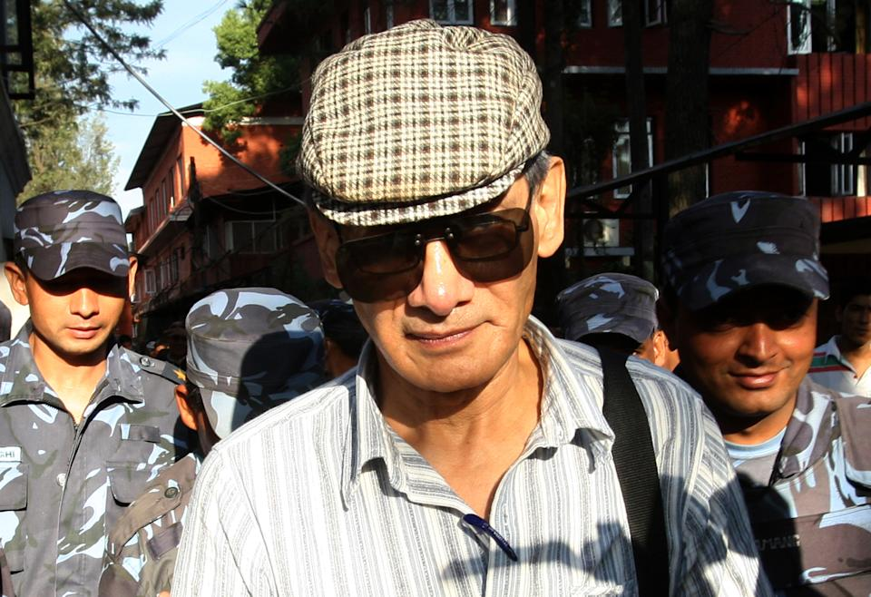 French serial killer Charles Sobhraj (C) is guided by Nepalese policemen towards a waiting vehicle after a court hearing in Kathmandu on May 31, 2011. Charles Sobhraj, a French citizen who is serving a life sentence in Nepal for the murder of an American backbacker in 1975, has been linked with a string of killings across Asia in the 1970s, earning the nickname