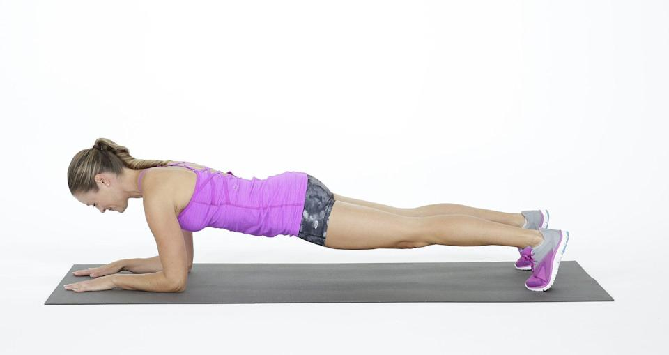 """<p>""""This is the king of core exercises,"""" said Kim Evans, ACE, personal trainer and fitness coordinator at <a href=""""https://slfac.com/"""" class=""""link rapid-noclick-resp"""" rel=""""nofollow noopener"""" target=""""_blank"""" data-ylk=""""slk:Spring Lake Fitness and Aquatic Center"""">Spring Lake Fitness and Aquatic Center</a>. """"The core is designed to stabilize and this one exercise does that.""""</p> <ul> <li>Get face-down on the floor resting on your forearms and knees.</li> <li>Push off the floor, raising up off your knees onto your toes and resting mainly on your elbows.</li> <li>Contract your abdominals to keep yourself up and prevent your booty from sticking up. Keep your back flat and glutes tight.</li> <li>Hold as long as you can. Aim for 20 to 30 seconds in the beginning, and work your way up to one minute as you get stronger.</li> </ul>"""