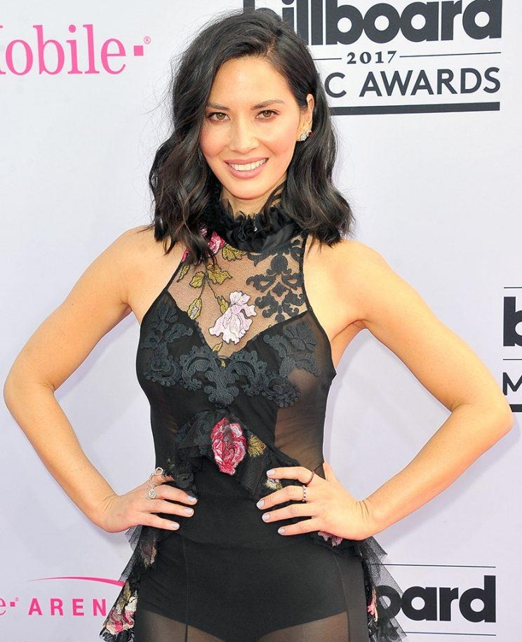 Actress Olivia Munn arrives at 2017 Billboard Music Awards.