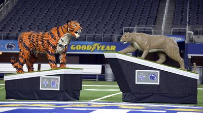 To celebrate the drive it takes to advance to the 84th annual Goodyear Cotton Bowl Classic, title sponsor Goodyear unveils life-sized tire sculptures of Penn State University's mascot, the Nittany Lion, and the University of Memphis' mascot, Tom the Tiger on Thursday, Dec. 26, 2019. Handcrafted by tire artist Blake McFarland, they will serve as centerpieces for the Goodyear Cotton Bowl Classic on Dec. 28, 2019, at AT&T Stadium in Arlington, Texas. (Matt Strasen/AP Images for Goodyear)