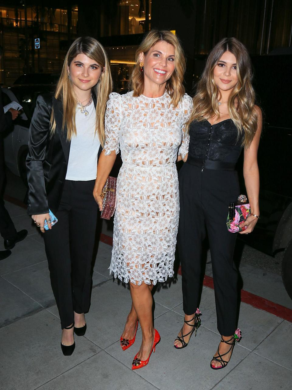 Lori Loughlin with her daughters Isabella and Olivia. (Photo: Getty Images)
