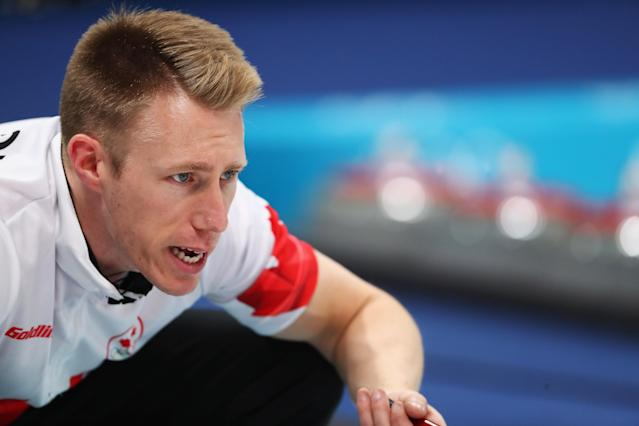 <p>Canada's Marc Kennedy throws the stone during the curling men's round robin session between Canada and Sweden during the Pyeongchang 2018 Winter Olympic Games at the Gangneung Curling Centre in Gangneung on February 17, 2018. </p>